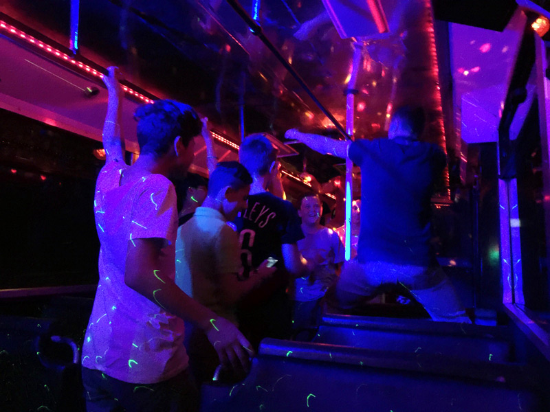 Boys are in dancing mood in party bus