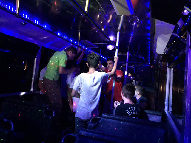 Friends having a great time in party bus
